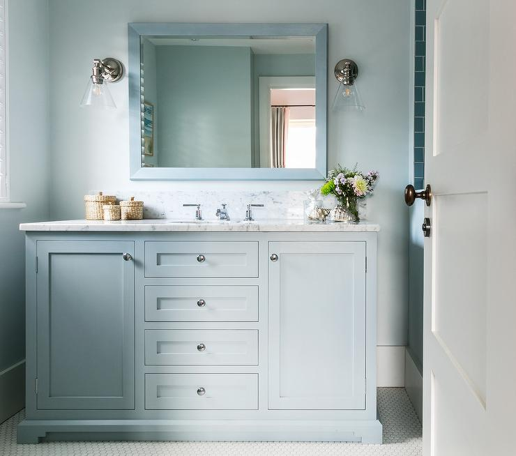 light blue bathroom colors offer a tranquil atmosphere seen on a washstand a framed mirror and wall paint finish - Bathroom Cabinets Colors