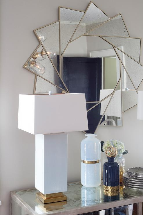 Mirrored Buffet Cabinet With White And Gold Lamp