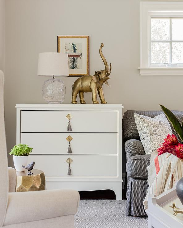 Gray Tassel Drop Pull Hardware On A White Dresser Adds Character In A  Transitional Living Room Displaying A Gold Elephant Statue Next To A Hand  Blow Glass ...