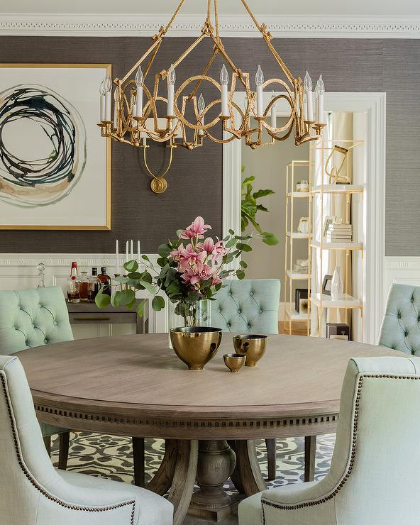 Green Tufted Linen Chairs At Round Wood Dining Table