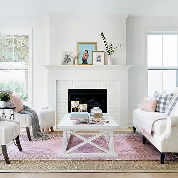 pink rug layered over beige bound sisal rug
