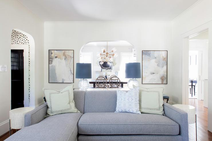 Gray Sofa With Chaise Lounge And Green Pillows