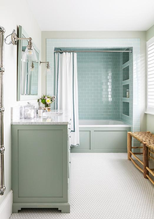Stacked Blue Subway Tiled Shower Niches In A Bathtub Alcove Add Noteworthy  Character Along With Blue Wainscoting Balanced By White Hex Floor Tiles.