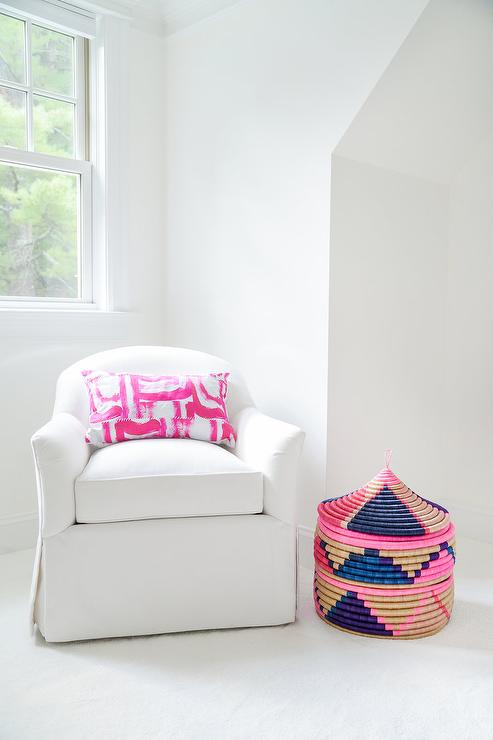 White Skirted Lounge Chair With Pink Pillow
