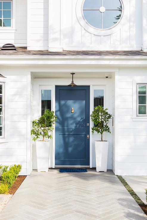Blue Front Door With Tall White Planters Transitional Home Exterior