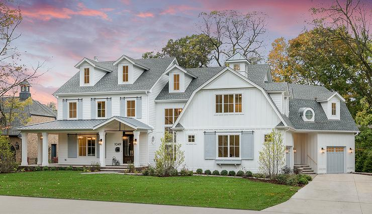 White Barn Home With Gray Shutters Transitional Home