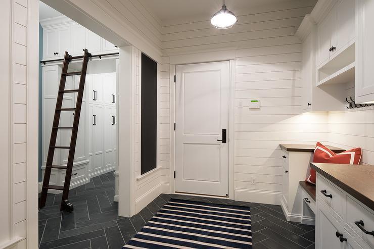 Long Mudroom With Dutch Door And Slate Herringbone Tile