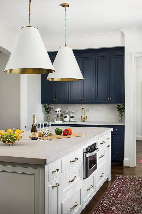 Green Cabinets With Brass And Concrete Pendant Lights