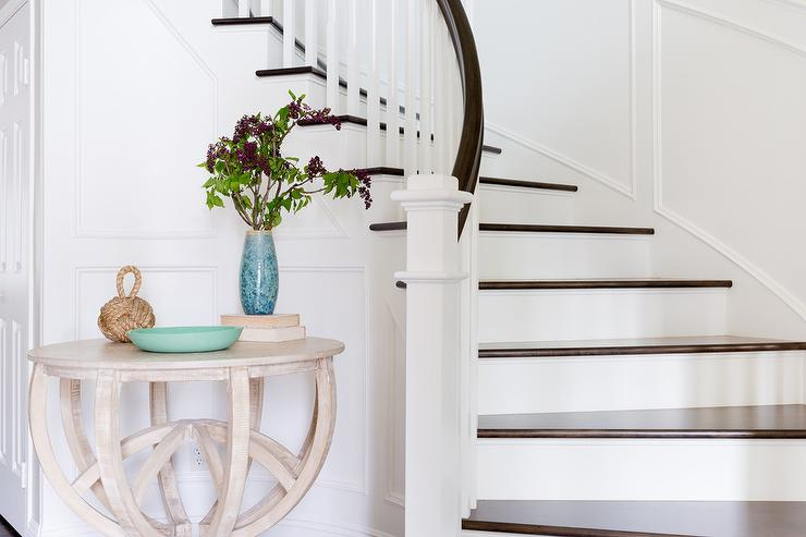 Round Whitewashed Wood Foyer Table In Curved Staircase
