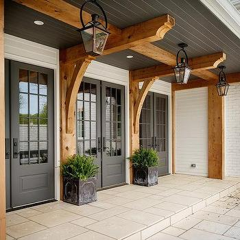 White Home With Black Double Doors