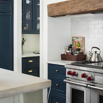 Blue Drawers With White Subway Tiles