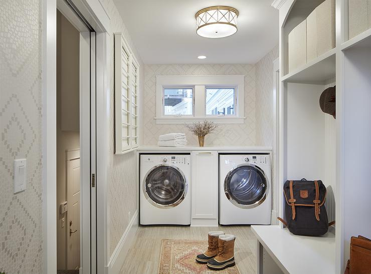 pull out cabinet between washer and dryer transitional laundry room. Black Bedroom Furniture Sets. Home Design Ideas