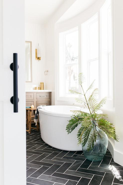 White Bay Window Bathtub On Dark Gray Slate Floors