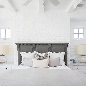 Charcoal Gray French Wood Panel Bed On White Brick Wall