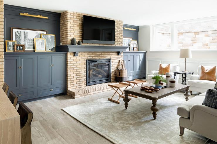 brick living room furniture. brick fireplace with blue built inccabinets