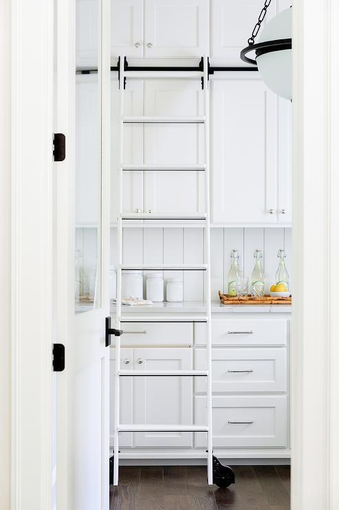 White Pantry With Black Ladder On Rails Design Ideas