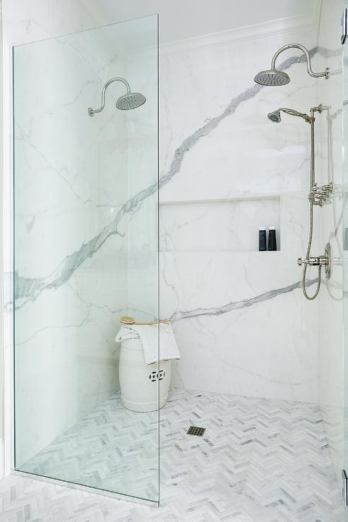 Genial Marble Herringbone Floor Tiles Lead Past A Glass Partition Into A Walk In  Shower Fitted With A Calcutta Marble Slab Surround Mounted Framing A Long  Marble ...