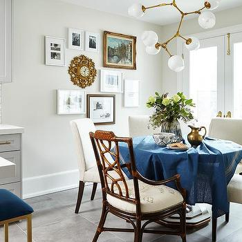 Blue Tablecloth Dining Table With Mismatched Chairs