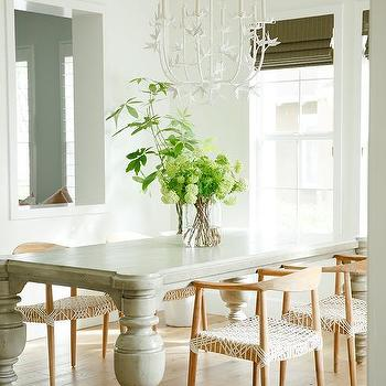 Gray Dining Table With Blond Mid Century Modern Chairs