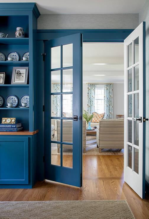 Two Tone White And Blue French Doors Open To A Gorgeous Blue Home Office  Fitted With Built In Blue Cabinets Accented With A Wood Countertop Mounted  Beneath ...