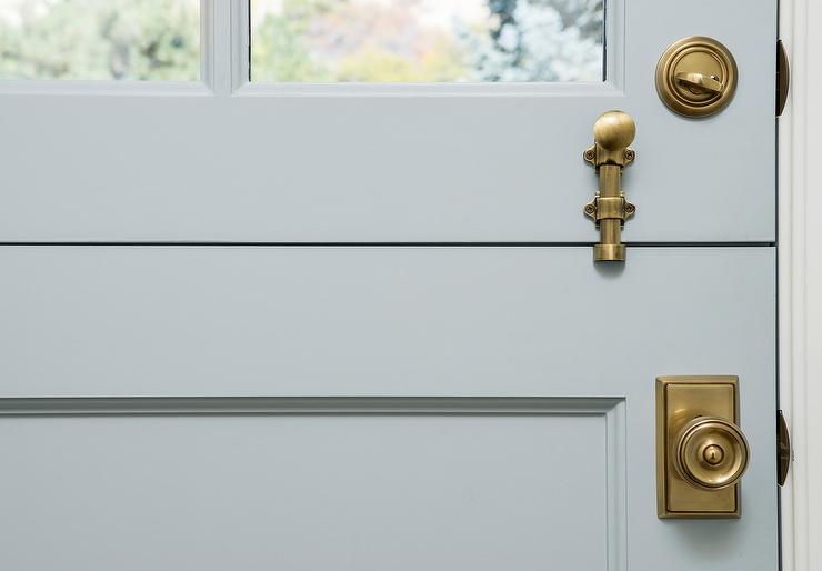 Antique Brass Door Knob On Gray Dutch Door