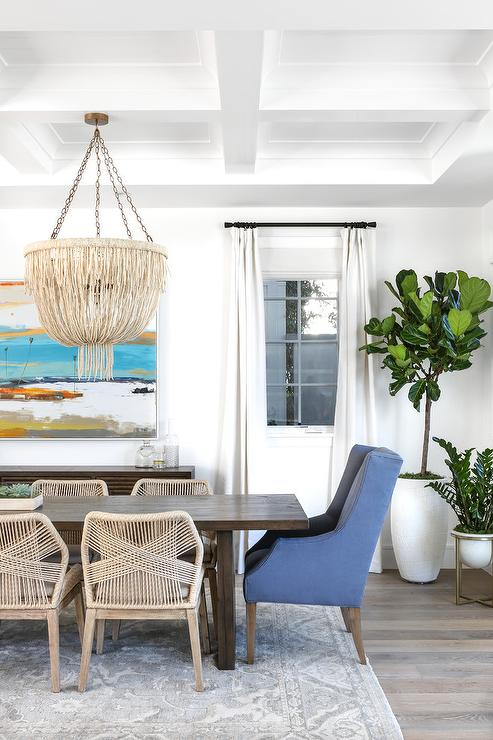 Wood And Woven Dining Chairs With Gray Wool Rug Transitional