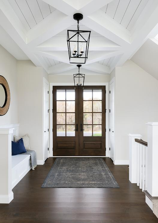 Double Walnut Front Doors With Gray Overdyed Rug