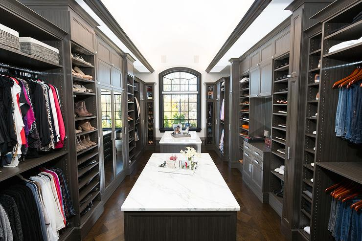 Dual Closet Islands with Honed White Marble - Transitional - Closet