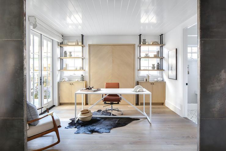 Modern White Sleek Desk With Black Cowhide Rug Transitional Den Library Office