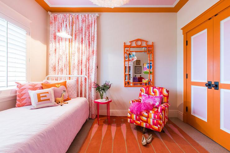 Pink and Orange Girls Bedroom with Orange Closet Doors ...