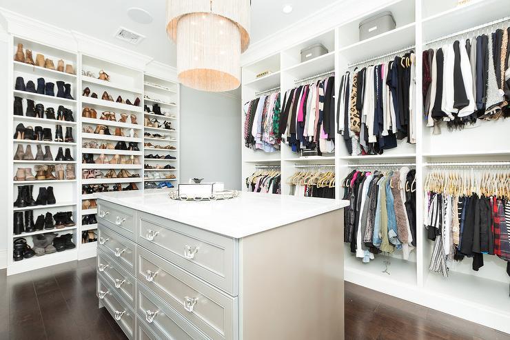 wall of custom shoe shelves transitional closet