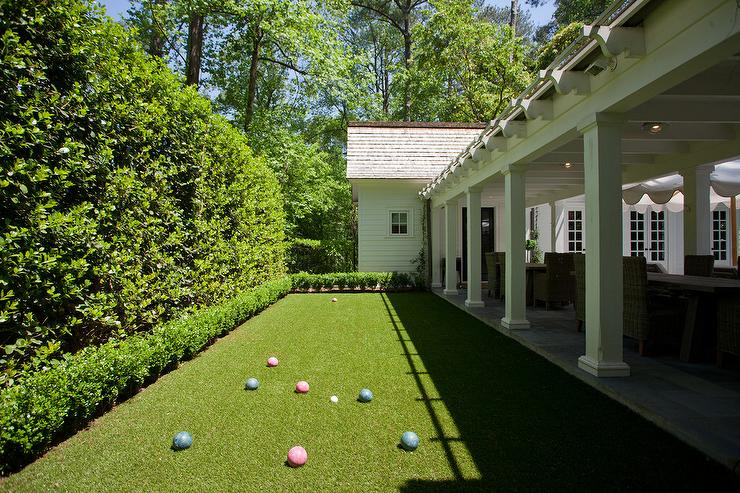 grass bocce ball court transitional deck patio