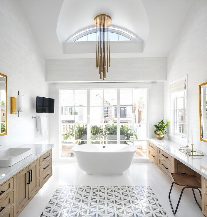 Staggered Gold Lights Over Oval Bathtub - Transitional - Bathroom