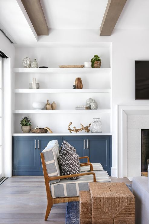 White Floating Shelves Over Blue Built In Cabinets
