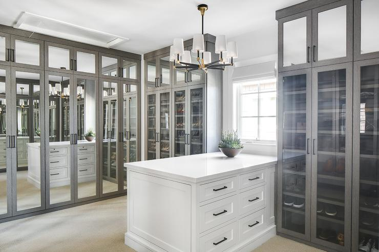 Gray Mirrored Closet Doors With White Island