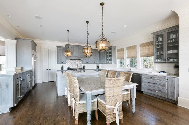 Gray Island With Turned Legs And Wicker Chairs