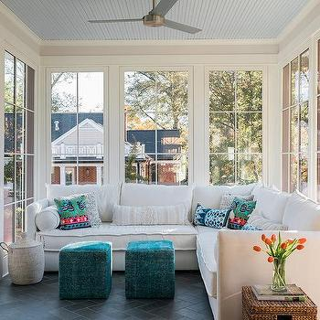 White Corner Sunroom Sectional With Peacock Blue Poufs
