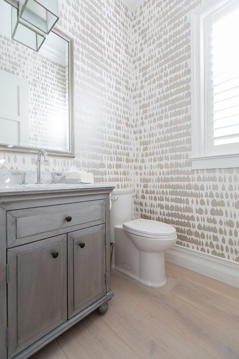 Queen Of Spain Wallpaper Creates An Artistically Stunning Textured Effect In White And Taupe A Transitional Powder Room