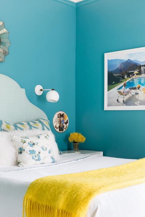 Peacock Blue Wall Paint Accents A White And Blue Print Headboard Positioned  Behind A Bed Covered In White Bedding Complemented With A Canary Yellow  Throw ...