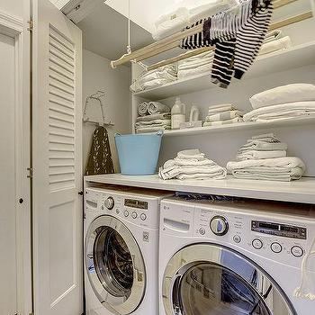Washer And Dryer In Closet With Folding Shutter Doors