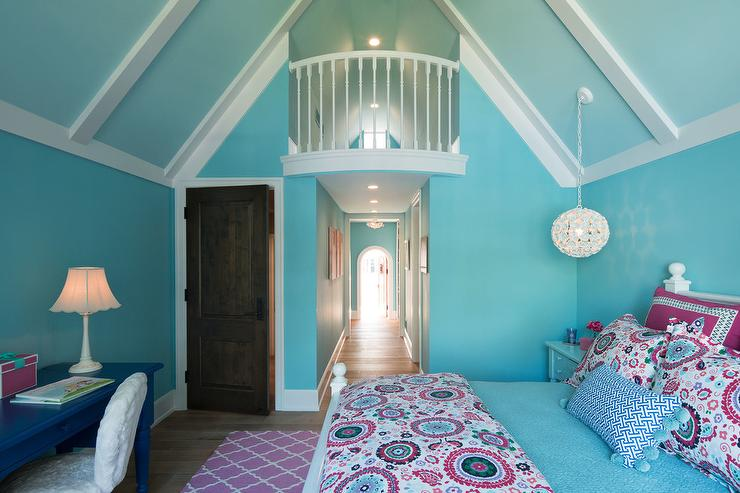 Welcoming Blue And Pink Girlu0027s Bedroom Features A White Wood Bed Dressed In  Pink And Blue Suzani Style Bedding Accented With A Blue Lumbar Pillow  Placed In ...