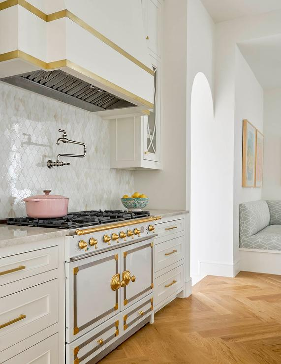 White And Gold Range Hood With White French Stove