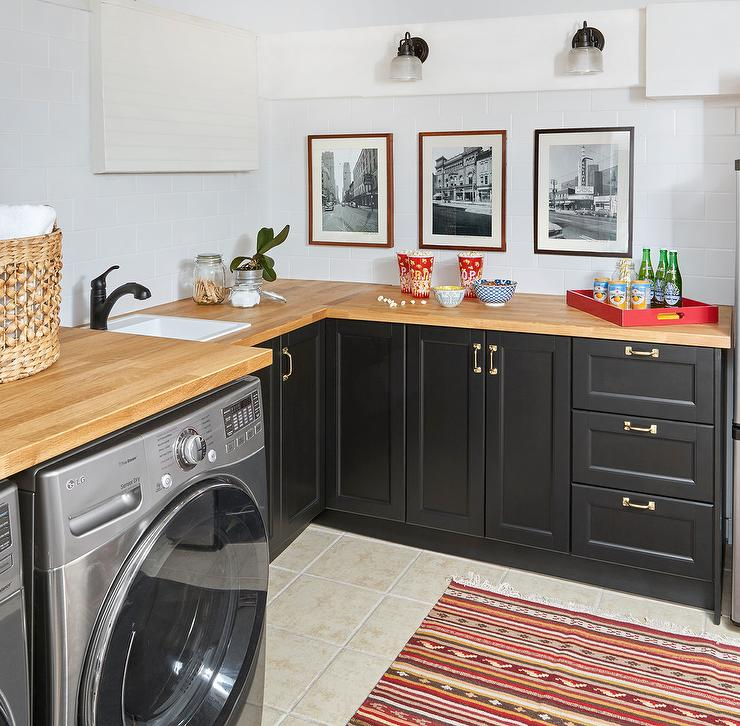 Black Laundry Room Cabinets With Blond Wood Countertops