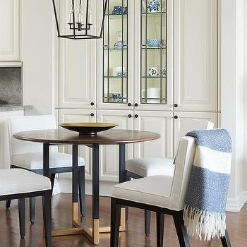 Round Wood Top Table With White Upholstered Chairs