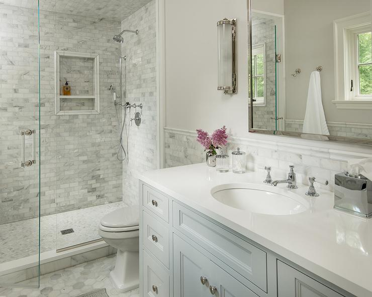 Light Gray Washstand With Marble Chair Rail Transitional Bathroom