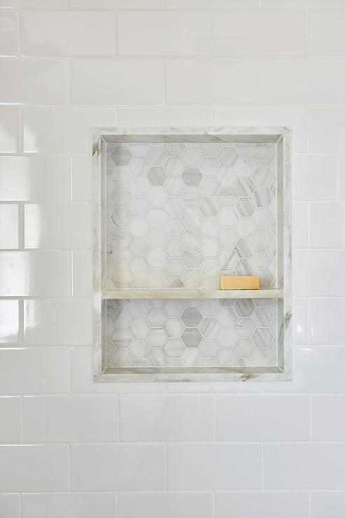White Subway Shower Tiles Frame A Niche Fitted With A Marble Shelf And  Marble Hex Tiles.