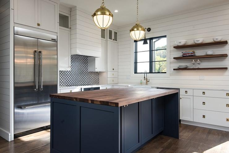 A Dark Blue Island With Walnut Countertop Stands Out Amongst White Shaker Perimeter Cabinetry And Shiplap Walls In Cottage Kitchen