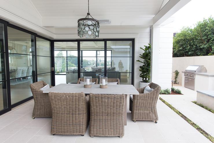 Gray Concrete Outdoor Dining Table With Brown Wicker Chairs