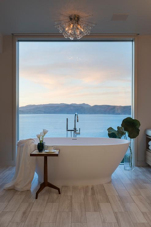 Oval Bathtub in Front of Floor to Ceiling Window - Transitional ...
