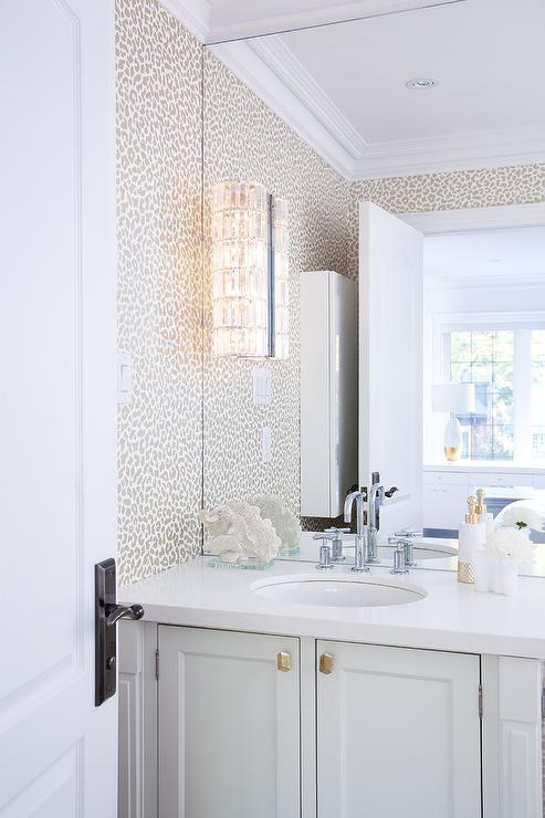 Gray And Gold Wallpaper With Sunburst Mirror